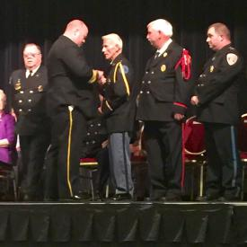 Chief Perillo pinning his father DVFA President Perillo