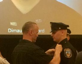 Officer DiMauro being pinned by his father.